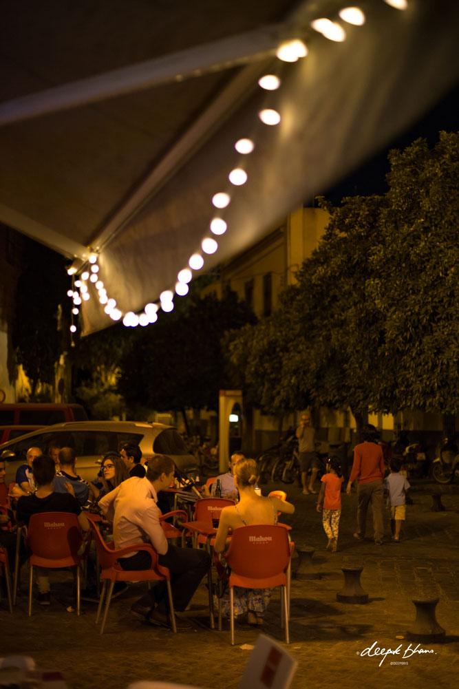 Seville-Spain-family-walking-fairy-light-cafe-night