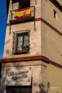 Spain-flag-hanging-window-Seville