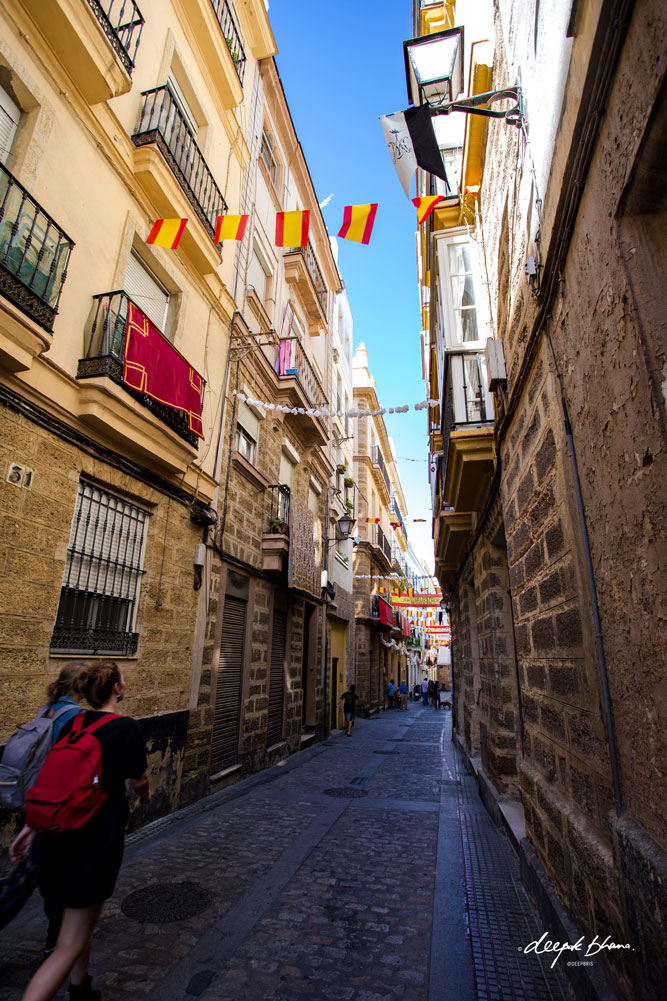 Cadiz-Spain-street-flags-tourists