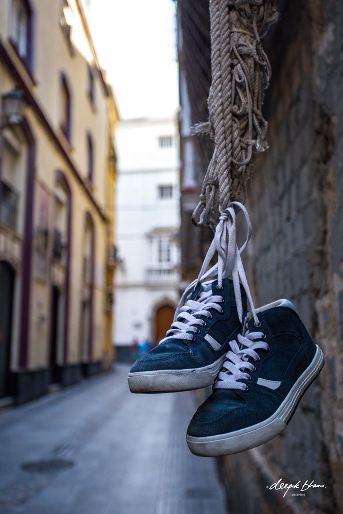 Cadiz-Spain-street-shoes-hanging